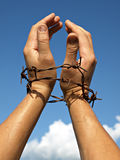 Pain. Raised hands of slave  to the blue sky Stock Photo