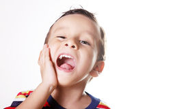 Pain. Child expressing pain and screaming with his hand in his face Stock Photos