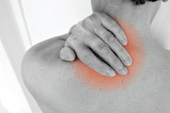 Pain. Woman with neck pain rubbing her neck with her hand Stock Photography