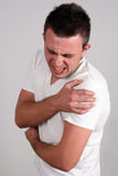 Pain. Young man has back pain ,  isolated Royalty Free Stock Images