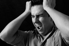 Pain. Man with headache screaming of pain Stock Photography