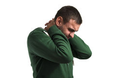 Pain. Young man with a pain in the neck isolated on white stock photos