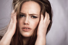 Pain. Woman in pain and sickness holding head royalty free stock photo