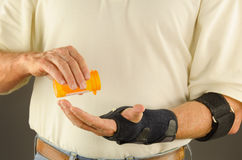 Pain anti-inflammatory tendinitis medication suffering Stock Photos
