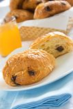 Pain Au Chocolat. On a plate with orange juice and basket royalty free stock photos