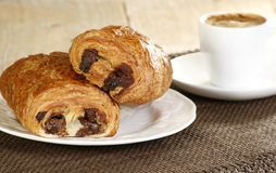 Pain au chocolat. Two delicious pain au chocolat with coffee Stock Photo