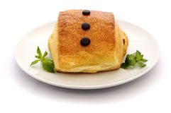 Pain au Chocolat and mint on a white. Stock Photos