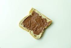 Pain avec de la crème de chocolat Image libre de droits