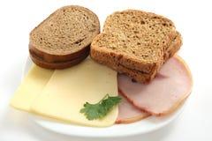 Pain avec du fromage et le jambon Images libres de droits