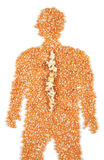 Pain in the back. Popcorn along the spine of a human has symbolically burst in pain Royalty Free Stock Photo