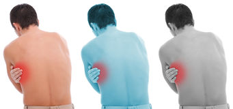 Pain in back. Young man holding his back, having pain Stock Photo