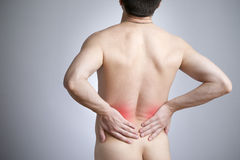 Pain in a back of the man Stock Image