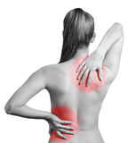 Pain in back. stock photos