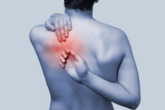 Pain in back Stock Images