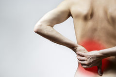 Pain on the background. The guy back pain and back pain Stock Photo