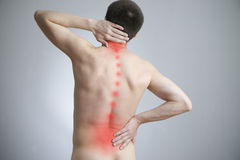 Pain in a body of the man. On gray background. Red dot Royalty Free Stock Images