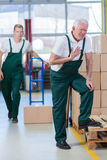 Pain in chest. Older warehouseman having pain in his chest Royalty Free Stock Photo