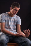 Pain concept - teenager holding his hand Stock Photos
