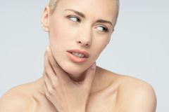 Pain concept. Young woman with touching her throat Royalty Free Stock Photography