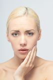 Pain concept. Young woman with touching her throat Royalty Free Stock Photo