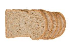 Pain de blé entier de tranche d'isolat Photographie stock libre de droits