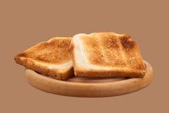 Pain de pain grillé sur le plateau en bois Images stock
