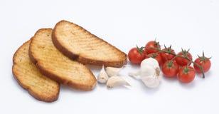 Pain de Toaste avec la tomate et l'ail Photographie stock