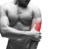 Pain in the elbow. Muscular male body. Isolated on white background with copy space Stock Photo
