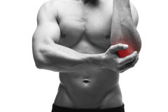 Pain in the elbow. Muscular male body. Isolated on white background Stock Photos