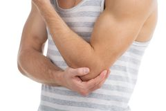 Pain in an elbow. Young strong man has seized for an elbow from a severe pain Stock Images