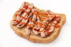 Pain enduit du pâté et du ketchup images libres de droits