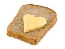 Pain et fromage en forme de coeur Photo stock
