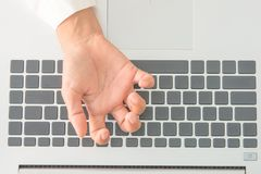 The pain of the fingers from work. stock images