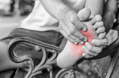 Pain in the foot. Massage of male feet. Pedicures. Stock Photos