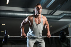 Pain and Gain. Man Doing Heavy Weight Exercise For Back Royalty Free Stock Images