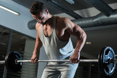 Pain and Gain. Man Doing Heavy Weight Exercise For Back Royalty Free Stock Photo