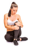 Pain. girl holds knee in his hands. isolated Royalty Free Stock Photos