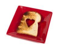 Pain grillé avec en forme de coeur Image stock