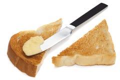 Pain grillé avec la margarine et le couteau Image libre de droits
