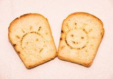 Pain grillé avec un visage souriant Image libre de droits