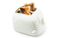Pain grillé dans un grille-pain Photo libre de droits