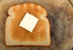 Pain grillé de beurre images libres de droits