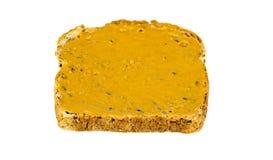 Pain grillé de beurre d'arachide d'isolement sur le blanc Photographie stock
