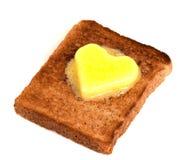 Pain grillé et beurre Photos stock