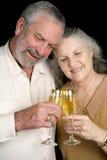Pain grillé mûr de Champagne de couples Photographie stock