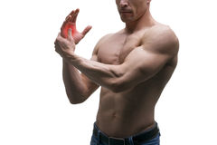 Pain in hand, carpal tunnel syndrome, muscular male body, studio isolated shot on white background. With red dot stock photos