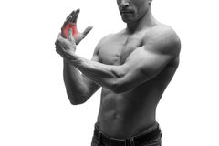 Pain in hand, carpal tunnel syndrome, muscular male body, studio isolated shot on white background with red dot Royalty Free Stock Photo