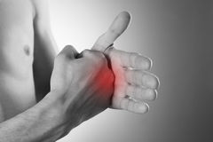Pain in the hand on a gray background Stock Photography