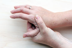 Pain in the hands Royalty Free Stock Photos