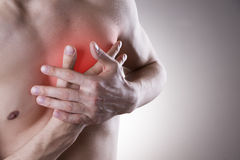 Pain in the heart of a man Stock Images